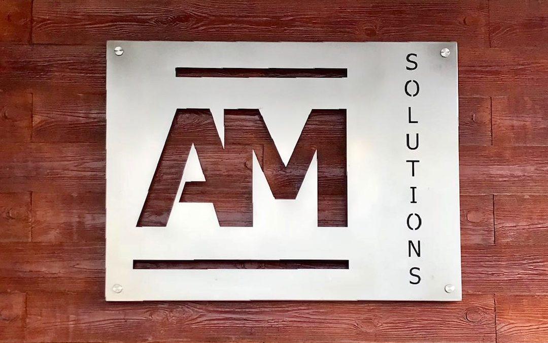 Szyld firmowy AM Solutions