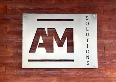 Company signboard AM Solutions
