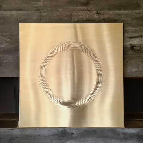 Sun in brass