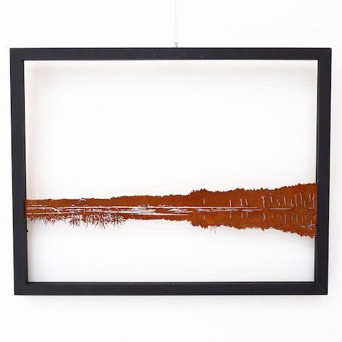 Corten artwork in a wooden frame
