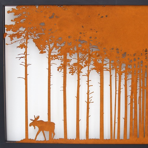 Corten artwork in a wooden frame – pine trees